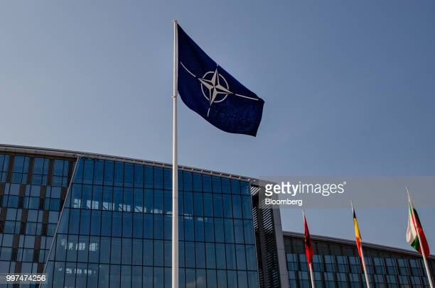 Star logo flag flies during the military and political alliance's summit at the North Atlantic Treaty Organization headquarters in Brussels Belgium...