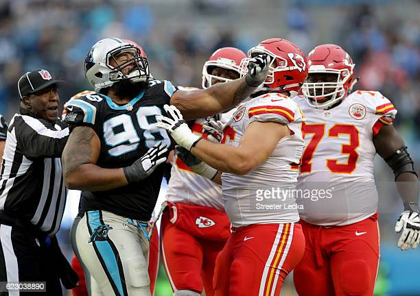 Star Lotulelei of the Carolina Panthers shoves Laurent DuvernayTardif of the Kansas City Chiefs after a play in the 4th quarter during their game at...