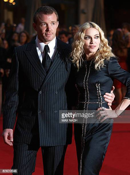 US star Madonna arrives with her husband US film director Guy Ritchie on September 1 2008 for the world premiere of his latest film 'Rocknrolla' in...