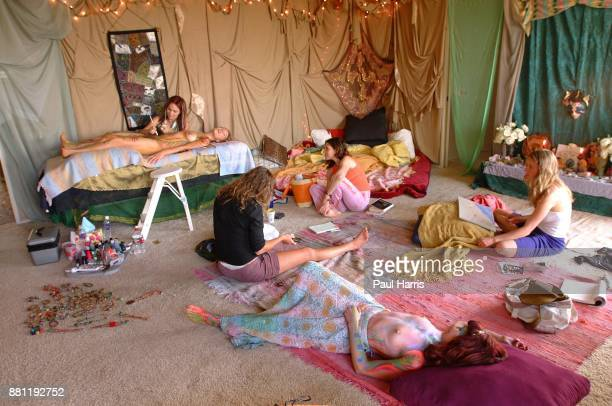Star Oakland paints Aleks Evangueldi as Marla Howard, a Goddess lays on the floor and other girls ask questions .Star Oakland has organized a...