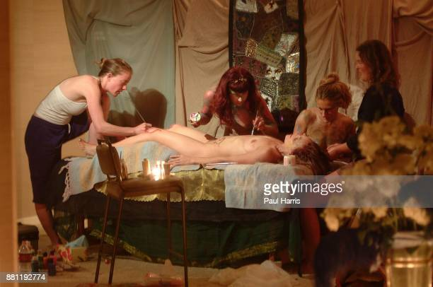 Star Oakland paints Aleks Evangueldi as Marla Howard a Goddess lays on the floor and other girls ask questions Star Oakland has organized a spiritual...
