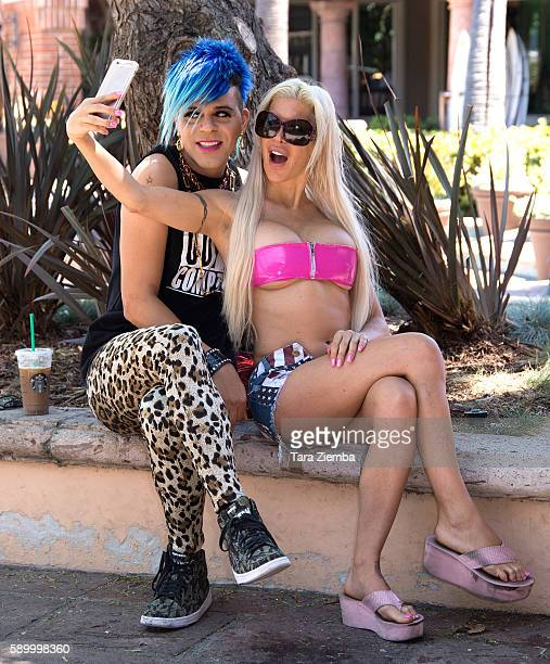 Star of Celebrity Big Brother 14 Angelique 'Frenchy Morgan' and artist/TV personality Sham Ibrahim take a selfie on August 15 2016 in Malibu...