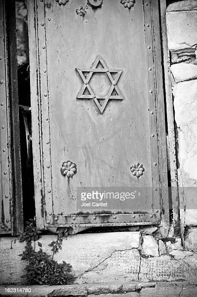 star of david door ajar - safed stock photos and pictures