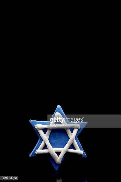 Star of david made of clay on a black background