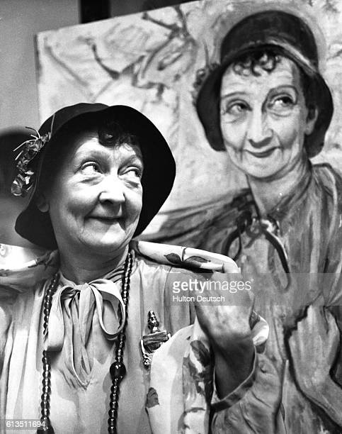 Star of the farce Watch It Sailor Esma Cannon beside her portraits 1960