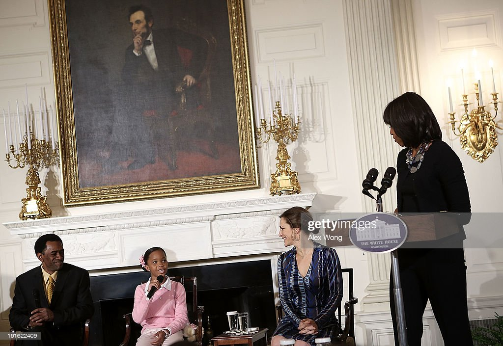 Star of the film Beasts of the Southern Wild Quvenzhane Wallis (2nd L) speaks as (L-R) cast member Dwight Henry, Executive Director of President's Commission on Arts and the Humanities Rachel Goslins, and first lady Michelle Obama look on during an interactive student workshop at the State Dining Room of the White House February 13, 2013 in Washington, DC. The first lady hosted middle and high school students from the DC area and New Orleans to participate in the event.
