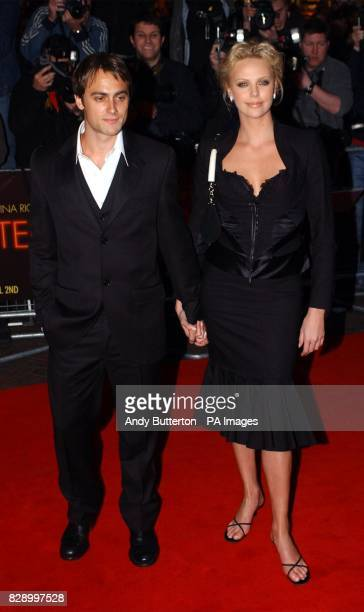Star of the film Charlize Theron and her boyfriend Stuart Townsend arrive for the UK premiere of Monster at the Vue cinema in Leicester Square...