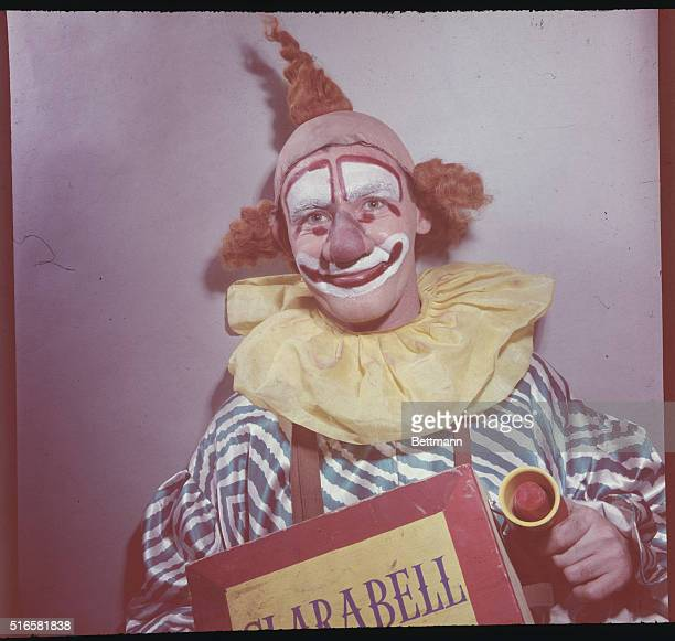 Star of The Howdy Doody Show the clown Clarabell displaying a sign bearing his name