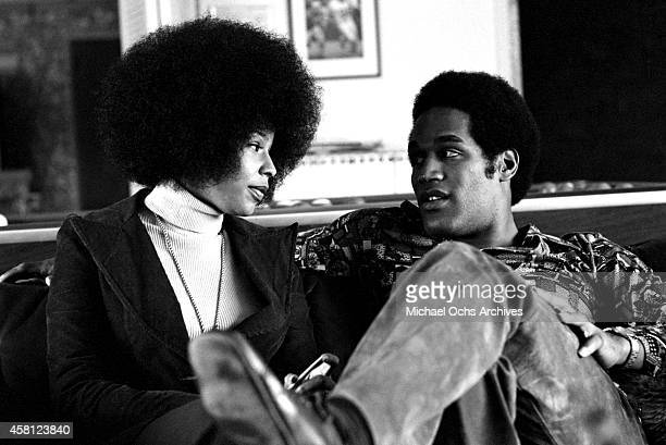 NFL star OJ Simspson poses for a portrait at home with his wife Marguerite Simpson while at home on January 8 1973 in Los Angeles California