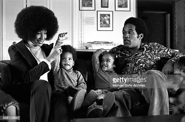 Star O.J. Simspson sits with his wife Marguerite Simpson, daughter Arnelle and son Jason during a portrait session on January 8, 1973 in Los Angeles,...