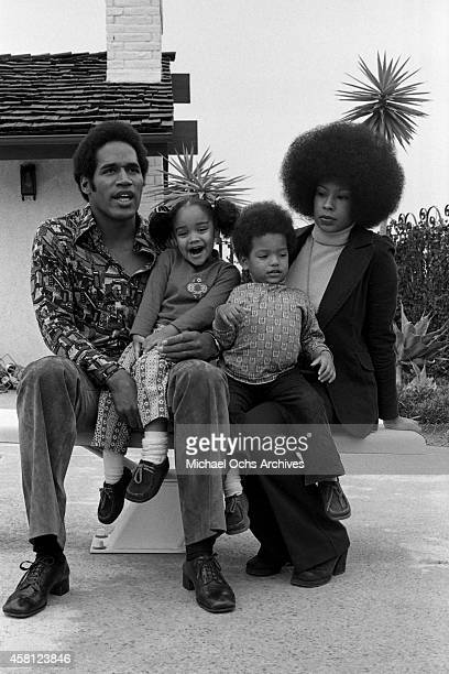 Star O.J. Simspson sits with his wife Marguerite Simpson, daughter Arnelle and son Jason pose for a portrait at home on January 8, 1973 in Los...