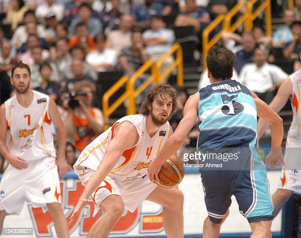 Star Pau Gasol of Spain plays some defence on Manu Ginobili of Argentina during the FIBA World Championship 2006 Semi Final at the Saitama Super...