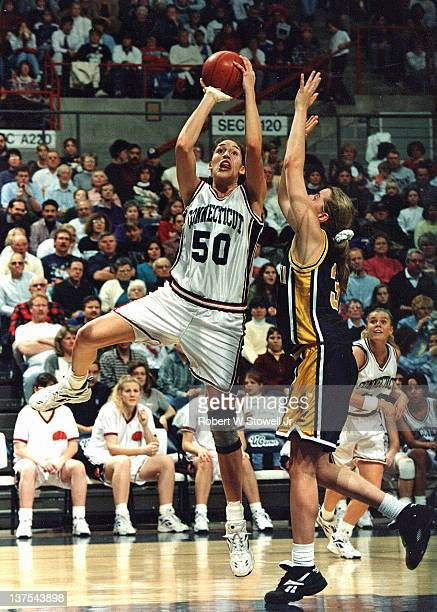 Star player Rebecca Lobo of the University of Connecticut women's basketball team shoots a jumper against Iowa in a game at Storrs CT 1995