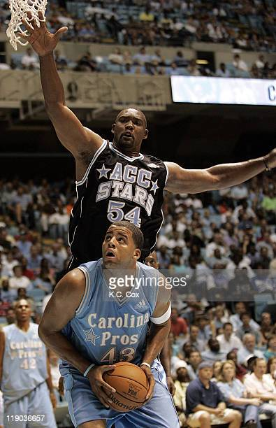 ACC Star Rodney Rogers leaps to block ACC Star Sean May during the 4th Annual World's Greatest Alumni Basketball Game Saturday August 27 at the Dean...