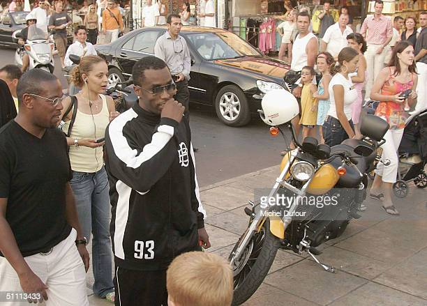 B star Sean PDiddy Combs and Andre Harrell are pictured on the streets of StTropez with bodyguards on July 24 2004 in France