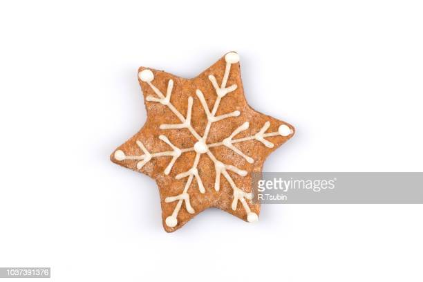 star shape christmas gingerbread cookie isolated on white background - christmas cookies stock pictures, royalty-free photos & images