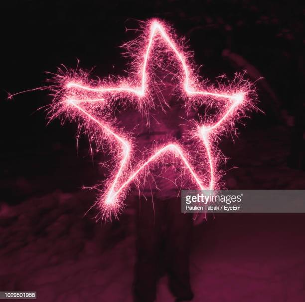 Star Shape Firework Display At Night
