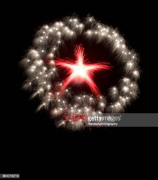 Star shape firework display at night