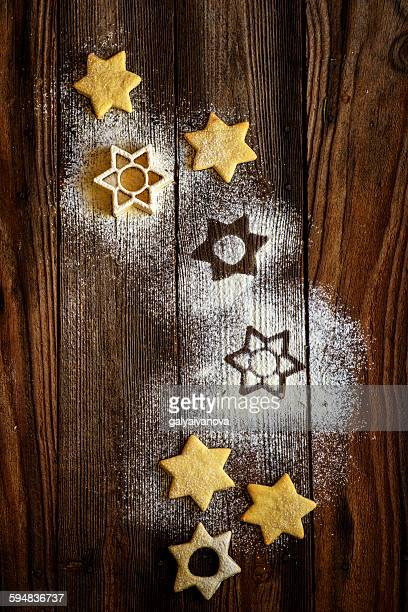 star shaped christmas cookies on a table - doily stock photos and pictures