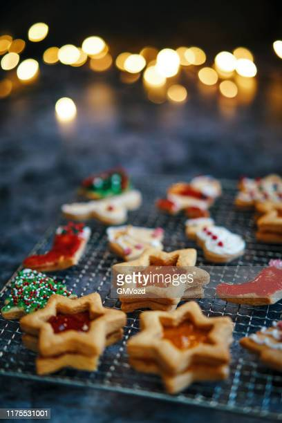 star shaped christmas cookies with marmalade - icing sugar stock pictures, royalty-free photos & images