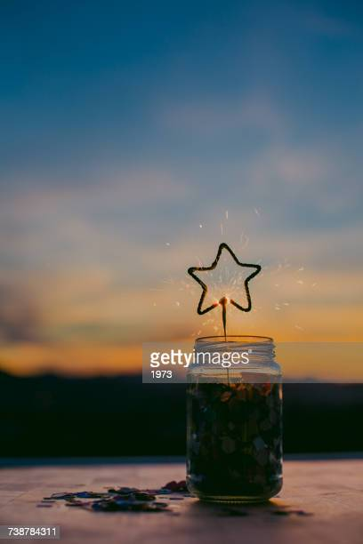 Star shaped sparkler in a glass jar