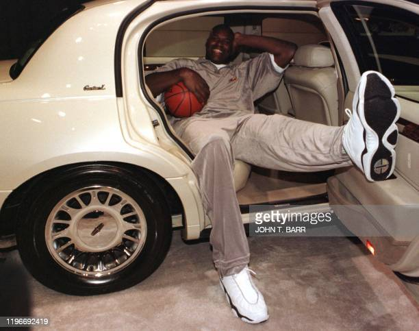 NBA star Shaquille O'Neil relaxes in the new Lincoln Cartier L Town Car which made its world debut at a news conference during the 2000 Greater Los...