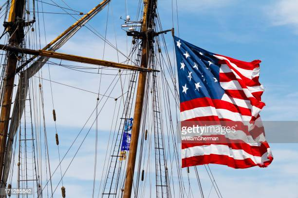 star spangled banner flying from pride of baltimore mast - fort mchenry stock photos and pictures