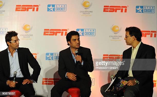 Star sports Commentators Harsha Bhogle and Wasim Akram listen to Sanjay Manjrekar during a press conference in New Delhi on September 17 2009 Sports...