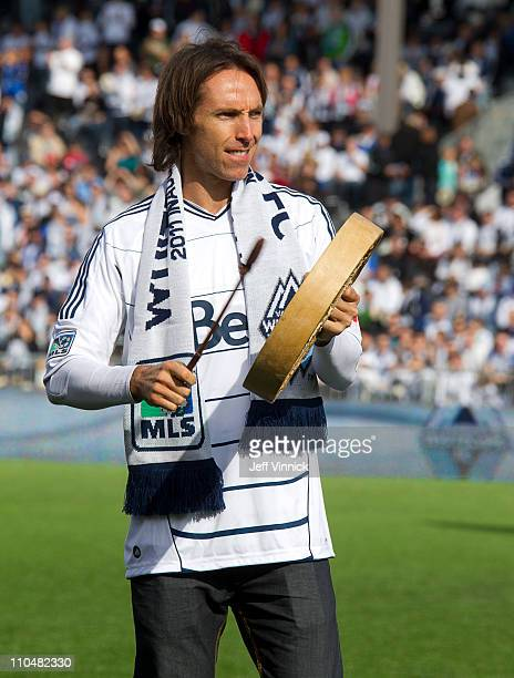 NBA star Steve Nash of the Phoenix Suns and part owner of the Vancouver Whitecaps beats a drum before the match against Toronto FC March 19 2011 in...