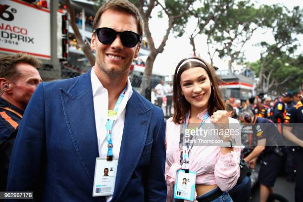 NFL star Tom Brady and supermodel Bella Hadid pose for a photo next to the Red Bull Racing team on the grid before the Monaco Formula One Grand Prix...
