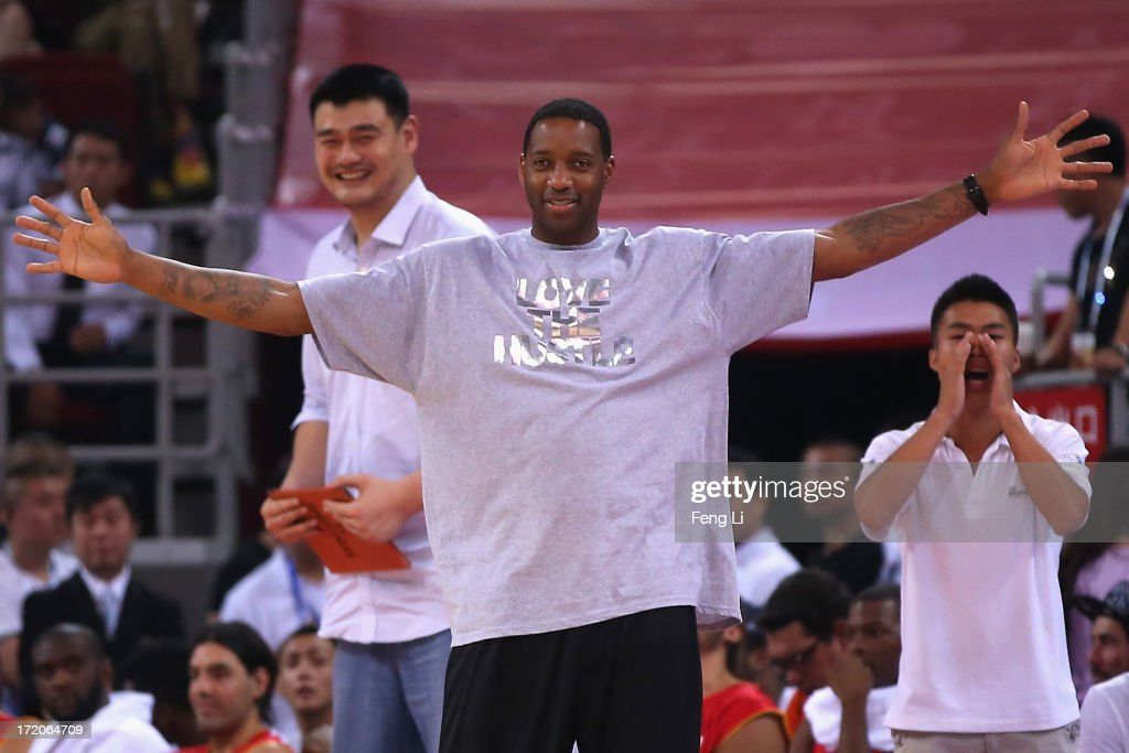 NBA star Tracy McGrady (Front) and Yao Ming (L) watch the Yao Foundation Charity Game, sponsored by the charity foundation initiated by former Chinese basketball star Yao Ming, during the 2013 Yao Foundation Charity Game between China team and the NBA Stars team on July 1, 2013 in Beijing, China.