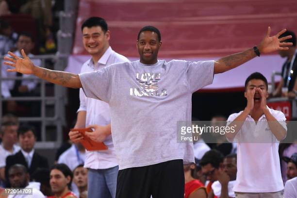 NBA star Tracy McGrady and Yao Ming watch the Yao Foundation Charity Game sponsored by the charity foundation initiated by former Chinese basketball...