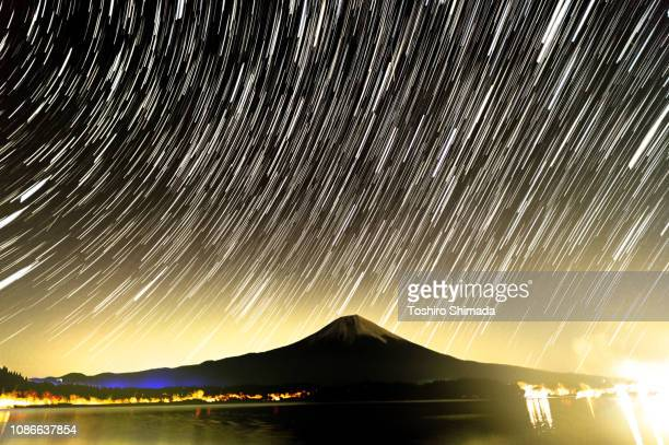 star trail and geminid meteor shower and mt.fuji - geminid meteor shower stock pictures, royalty-free photos & images