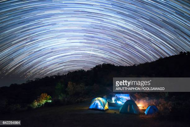 Star trail on the mountain camping nature landscape