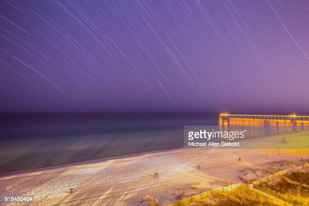 star trail over panama city beach - panama city beach stock pictures, royalty-free photos & images
