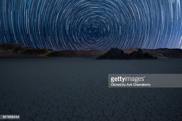 Star trail over race track death valley at night