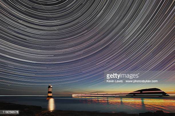 star trail over trwyn du lighthouse - guidance stock pictures, royalty-free photos & images
