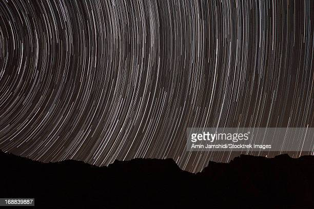Star trails above a valley in the Firoozkooh area, Iran.