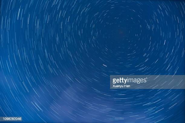 star trails at night - dark blue stock pictures, royalty-free photos & images