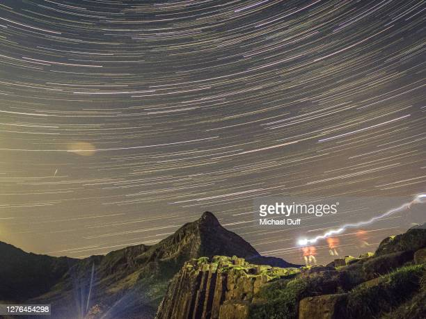 star trails at the giant's causeway in northern ireland - space and astronomy stock pictures, royalty-free photos & images