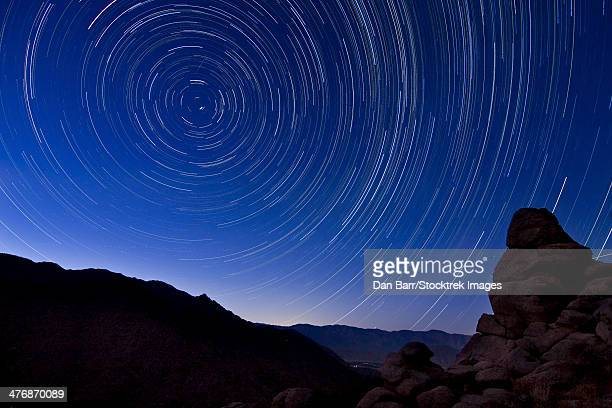 Star trails from a vista overlooking Borrego Springs and the Santa Rosa Mountains in Anza Borrego Desert State Park, California.