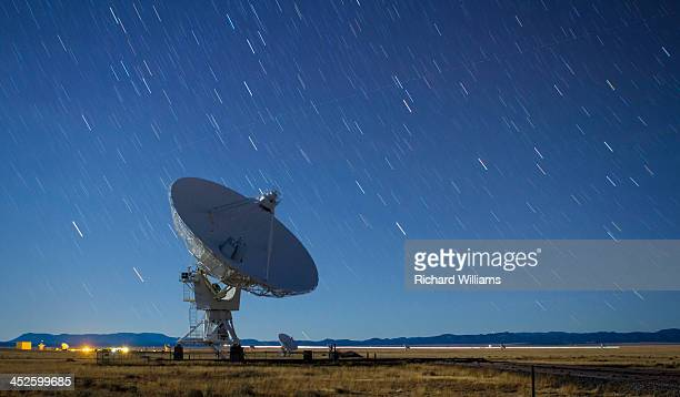 CONTENT] Star trails on a clear night behind a radio astronomy antenna at the Very Large Array near Socorro New Mexico