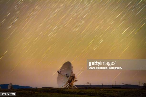 Star Trails over a large radio telescope at the Karl G. Jansky Very Large Array in the Plains of San Agustin in New Mexico