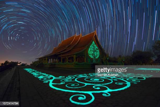 star trails over amazing buddhist church in thailand, sirindhorn wararam phu prao temple (wat phu prao). - 南東 ストックフォトと画像