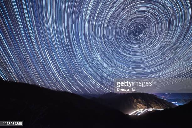 star trails over beijing countryside - north star stock pictures, royalty-free photos & images