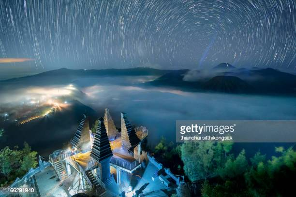 star trails over bromo volcano, indonesia - tengger stock pictures, royalty-free photos & images