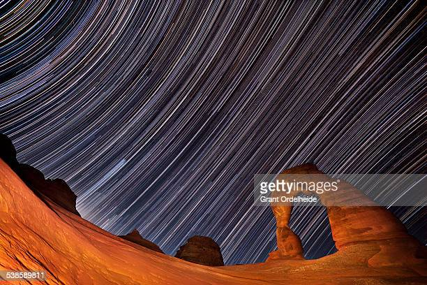 Star trails over Delicate Arch in Utah.