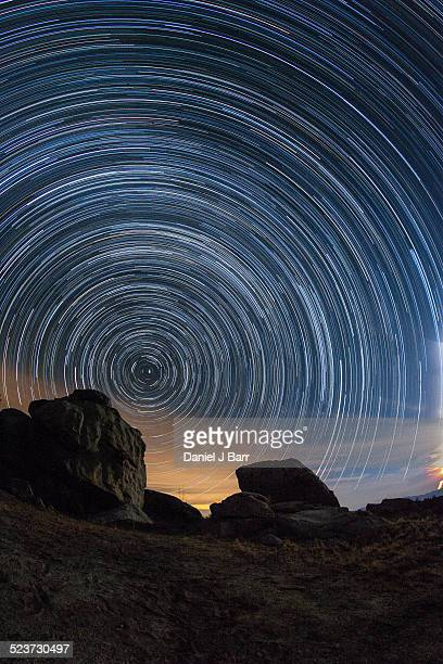 star trails over granite boulders - north star stock photos and pictures
