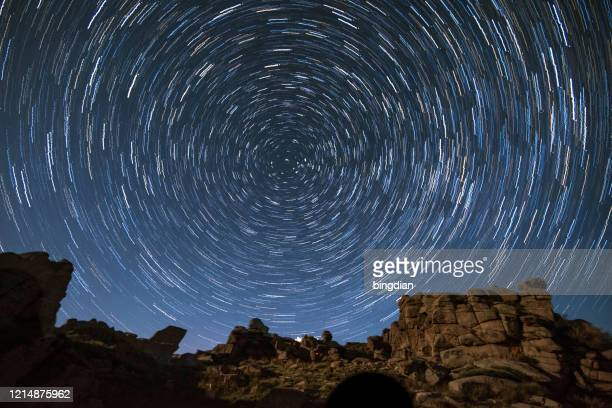 star trails over iceberg beams in china - star trail stock pictures, royalty-free photos & images