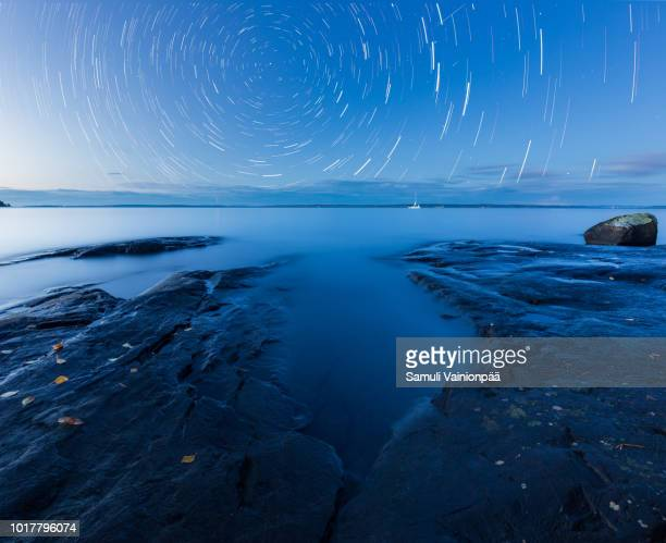 star trails over lake näsijärvi, tampere, finland - tampere finland stock pictures, royalty-free photos & images